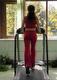 Woman run in health club. And window with autumn Royalty Free Stock Photos