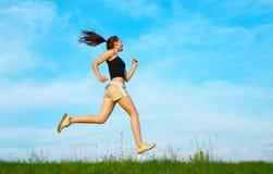 Woman Run On Green Grass Stock Image