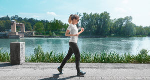 Woman run on the river, fitness Stock Photography