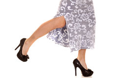 Woman run in skirt legs heel up Royalty Free Stock Photo