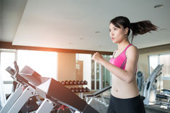 Woman run on treadmill. In the gym stock images