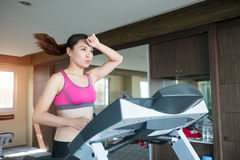 Woman run on treadmill Stock Photo