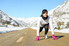 Woman run in winter landscape road. Woman running on winter mountain road. Caucasian female athlete ready to run on snow landscape Stock Photography