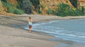 Woman runing on the beach stock footage