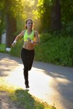 Woman runner athlete in park.  Royalty Free Stock Image