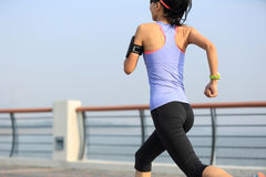 Woman runner athlete running at seaside Royalty Free Stock Photography