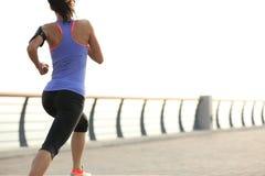 Woman runner athlete running at seaside Stock Photography