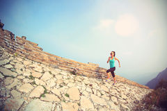Woman runner athlete running on trail at chinese great wall Royalty Free Stock Photo