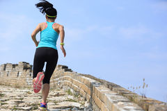 Woman runner athlete running on trail at chinese great wall Stock Images