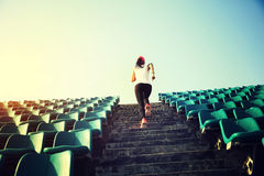 Woman runner athlete running up on stairs royalty free stock photo
