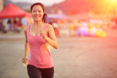 Woman runner at beach Stock Photos