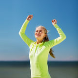 Woman runner celebrating victory Royalty Free Stock Image