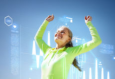 Woman runner celebrating victory Stock Image