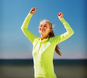 Woman runner celebrating victory stock images