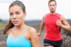 Woman runner closeup - running couple Stock Photography