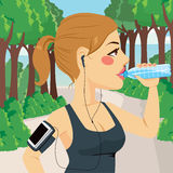 Woman Runner Drinking Water Royalty Free Stock Image