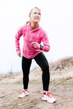 Woman runner exercising and stretching, autumn nat Royalty Free Stock Photos