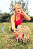 Woman runner exercising and stretching, summer nature outdoors. Happy Smiling Young Woman Runner Exercising and Stretching Fitness in Summer Nature Outdoors Royalty Free Stock Images