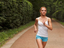 Woman Runner. Fitness Girl Running outdoors Stock Photos