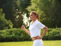 Woman Runner. Fitness Girl Running outdoors Stock Photo