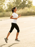 Woman Runner. Fitness Girl Running outdoors Stock Image
