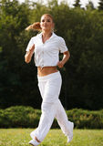 Woman Runner. Fitness Girl Running outdoors Royalty Free Stock Photography