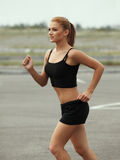 Woman Runner. Fitness Girl Running outdoors Royalty Free Stock Image