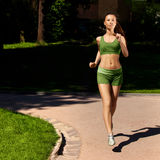 Woman Runner. Fitness Girl Running outdoors Stock Images