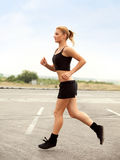 Woman Runner. Fitness Girl Running outdoors Royalty Free Stock Photos