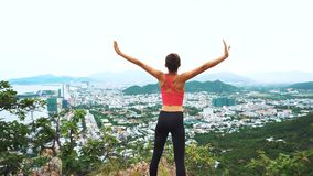 Woman runner happy and celebrating success. Female run on top of the mountain, cheering in winning gesture. 4K stock footage