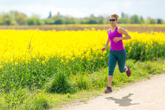 Woman runner happy running jogging on sunny day Stock Photo