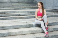 Woman runner is having break royalty free stock image