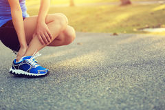 Woman runner hold her sports injured ankle Royalty Free Stock Image