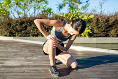 Woman runner hold her sports injured knee Royalty Free Stock Images