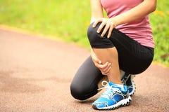 Woman runner holder her sports injured knee Stock Images