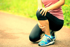 Woman runner holder her sports injured knee Royalty Free Stock Photography