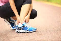 Woman runner holder her twisted ankle Stock Images