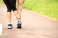 Woman runner holder her twisted ankle Stock Photography