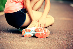 Woman runner holder her twisted ankle Stock Image