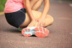 Woman runner holder her twisted ankle Royalty Free Stock Photography