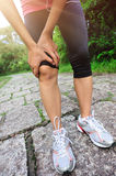Woman runner injured knee Royalty Free Stock Photo