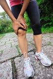 Woman runner injured knee Stock Photo