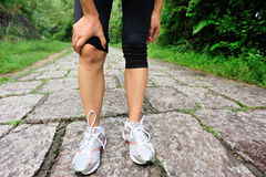 Woman runner injured knee Stock Photo