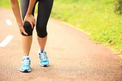 Woman runner injured knee Royalty Free Stock Photo