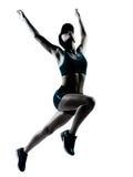 Woman runner jogger jumping Royalty Free Stock Image