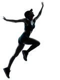 Woman runner jogger jumping Royalty Free Stock Image