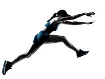 Woman runner jogger jumping Royalty Free Stock Photos