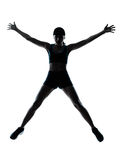Woman runner jogger jumping happy Stock Image