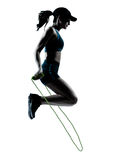 Woman runner jogger jumping rope Royalty Free Stock Image