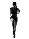 Woman runner jogger jumping silhouette Royalty Free Stock Image